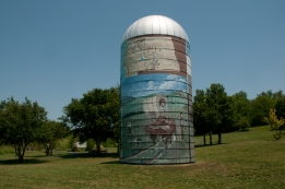 Silo with Oregon Trail Mural at Oregon Trail Nature Park west of St Marys Kansas.