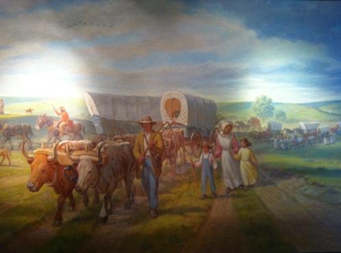 Bucolic rendering of pioneers along the Oregon Trail through Northern Kansas. Hollenberg Museum, Kansas.