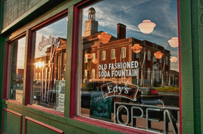 Independence Courthouse reflected in drugstore window where a young Harry Truman once worked. Independence Square, Independence Missouri