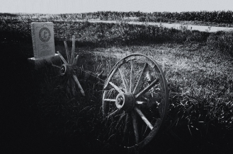 Wagon remnants beside granite marker designating the site of the Kiowa Pony Express Station along the Little Blue river, Nebraska.