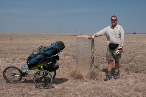 Bart beside stone marker placed by Ezra Meeker designating the route of the Oregon Trail west of Guernsey Wyoming.