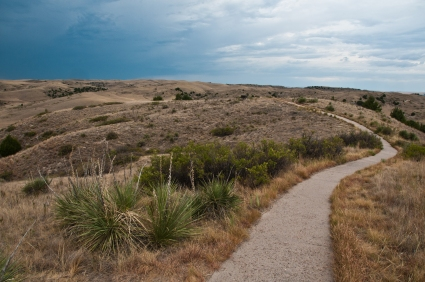 Paved pathway leads to location where the Oregon Trail begins steep descent into Ash Hollow Spring. Ash Hollow State Historic Park Nebraska.