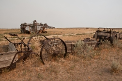 Farm machinery along the Council Bluffs route of the Oregon Trail east of Glenrock Wyoming.
