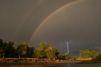 Rainbow and lightening along the Platte River. Near Cozad Nebraska.