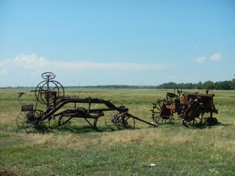 Anitique farm equipment along the Oregon trail east of Cozad Nebraska.