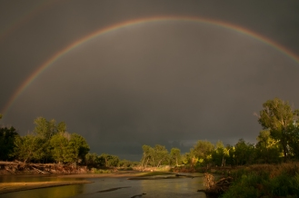 Rainbow over the Platte River from passing summer thunderstorm near Cozad Nebraska.