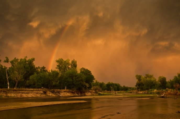 Rainbow along the Platte River from passing thunderstorm near Cozad Nebraska.