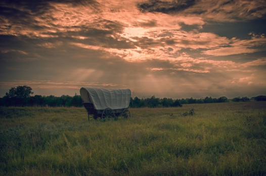 Lone covered wagon on Prairie at Rock Creek State Historic Park, Nebraska.