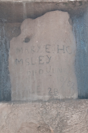 Mary Homsley Grave Stone (behind protective plexiglass). She was buried about a mile north of Fort Laramie. Wyoming.