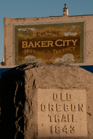 Oregon trail granite memorial and mural, downtown Baker City, Oregon.