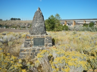 Monument to the Oregon Trail above American Falls Dam. American Falls, Idaho.