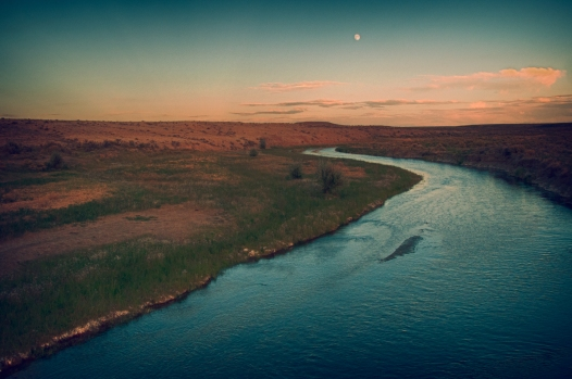 Moon rise over The Big Sandy River near Big Timber Pony Express Station site. Wyoming.